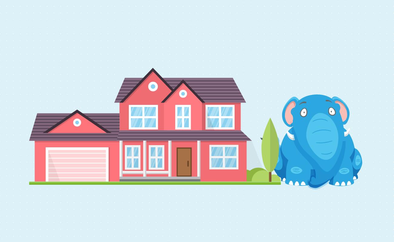 Elephant beside a fancy house.