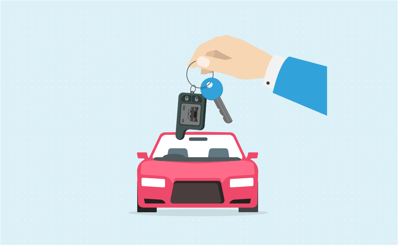 Hand dangling keys on a new car.