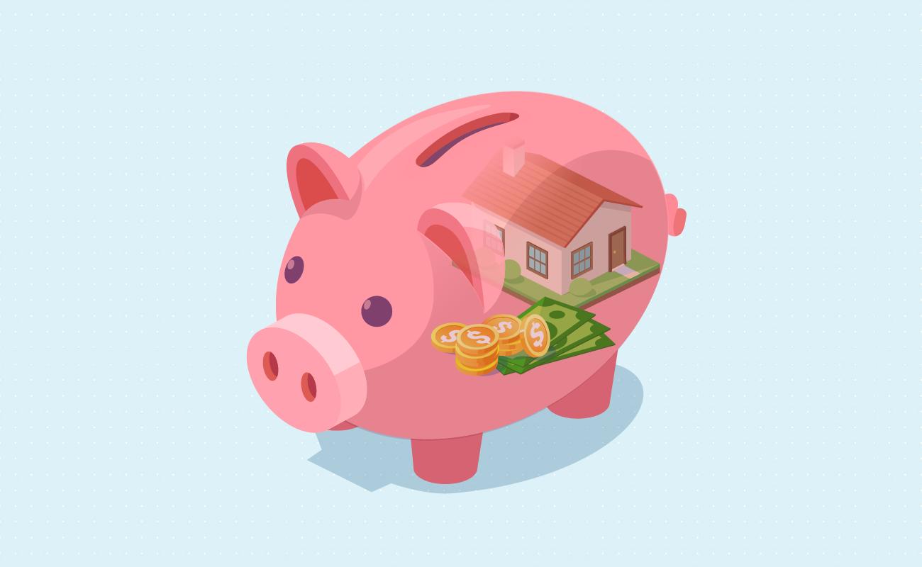House and savings inside a piggy bank.