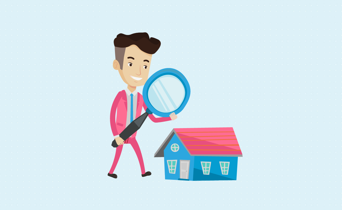 Man examining house with magnifying glass.