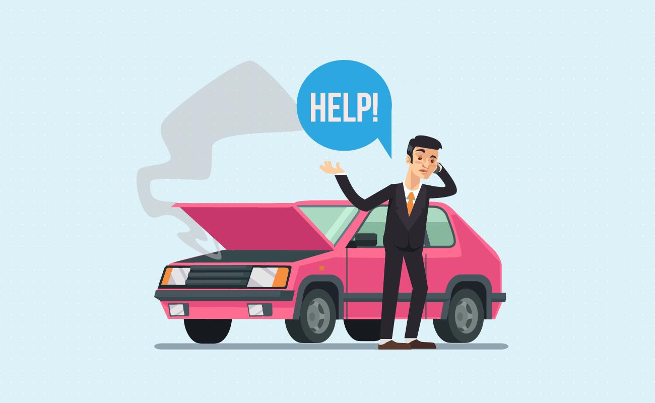 Man with broken car calling a mechanic.